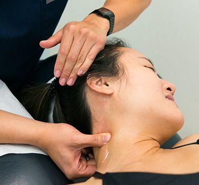 chiropractor examining patients neck