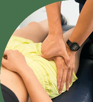 massage therapist wearing protective equipment