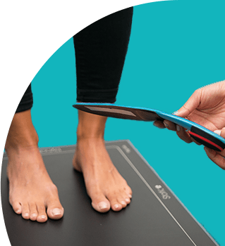 patient standing on gait scan plate