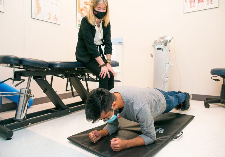physiotherapist evaluating patient lg