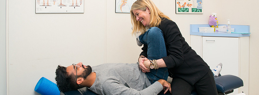 physiotherapist treating patient with hip pain