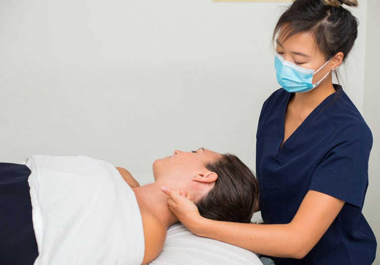 registered massage therapist treating patient lg