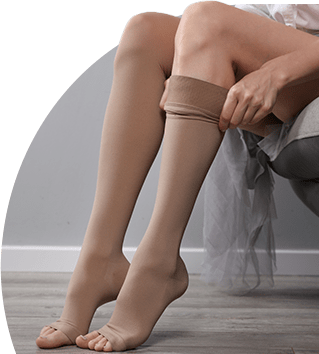 women putting on compression stockings